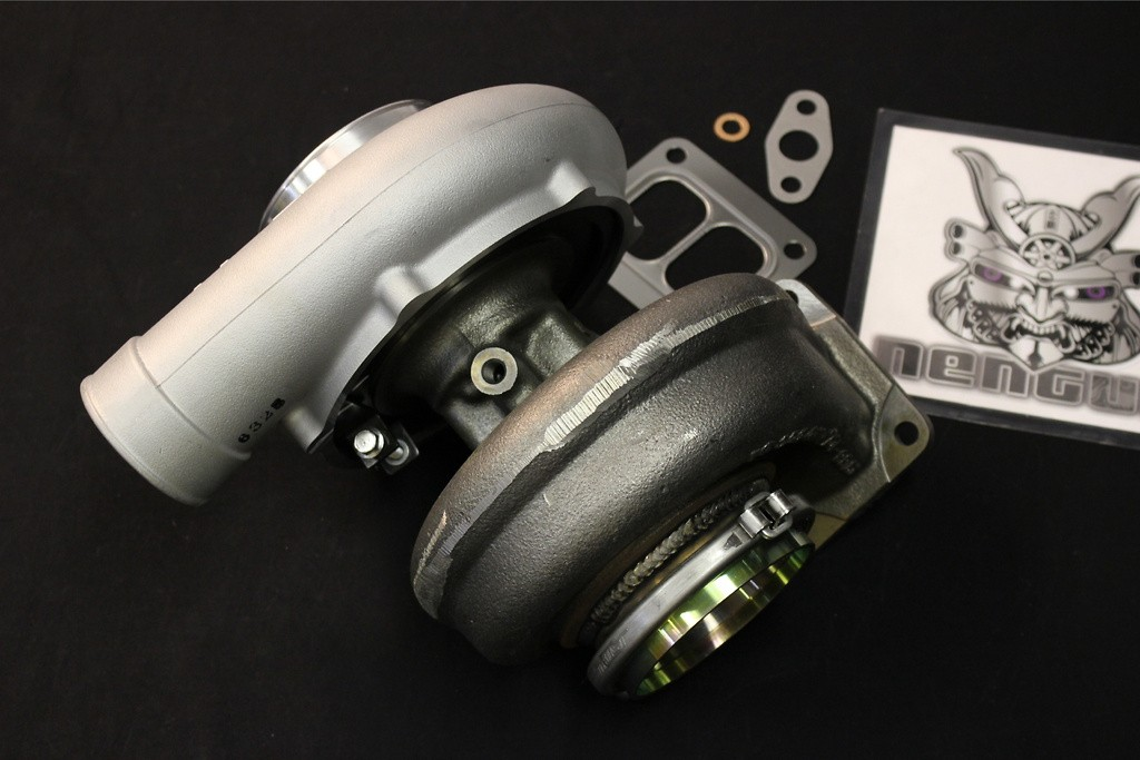 Type: T88H - Compressor: 38GK - Exhaust Housing: 22.0cm2 - Outlet: 94mm Coupling Adapter - 11500325