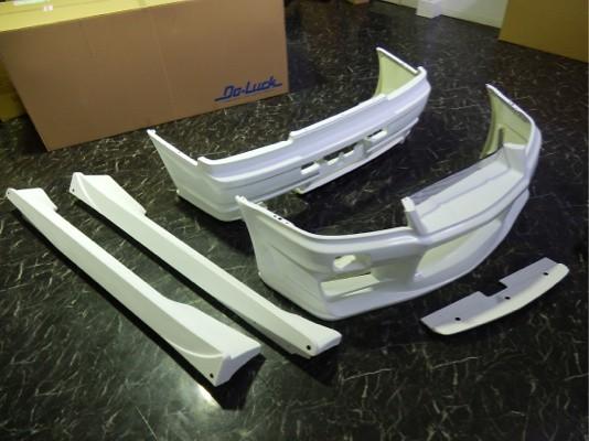 Front Bumper, Rear Bumper & Side Diffusers - Construction: FRP - Colour: Unpainted - BNR34 3P Kit
