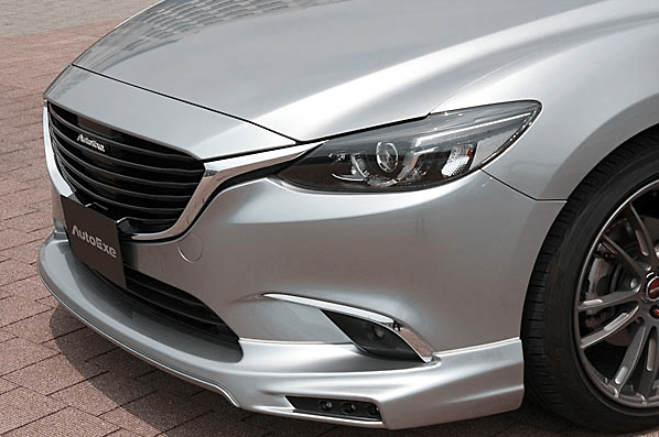 Front Grille Garnish - Construction: ABS - Colour: Piano Black - MGJ2510