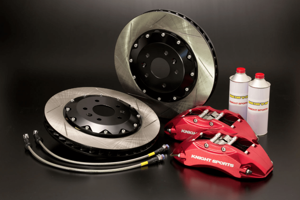 18inch and larger wheels - Set: Front - Caliper Type: 6POT - Colour: Red - Rotor Type: 2 Piece/Slit