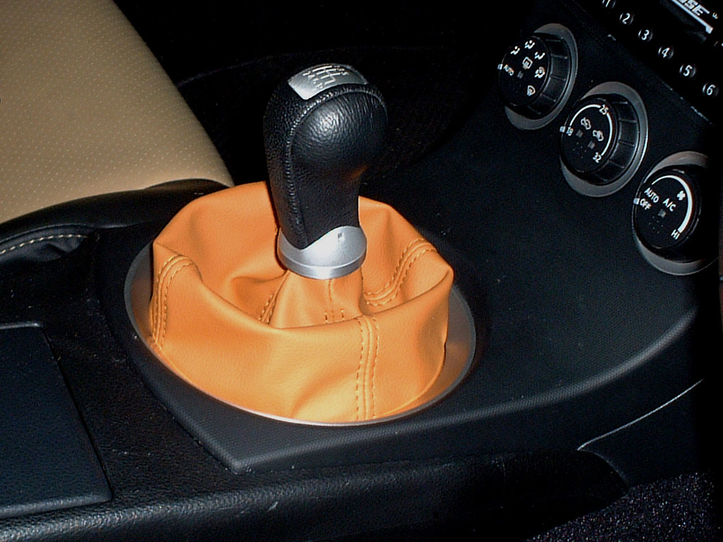 Shift Boot Cover - Color: Black Carbon - Color: Blue Carbon - Color: Dark Silver Carbon - Color: Orange - Color: Orange Carbon - Color: Pearl White Carbon - Color: Red Carbon - Color: Silver Carbon - Color: Yellow Carbon - Material: Synthetic Leather - INT-Z33-SHI-BOO