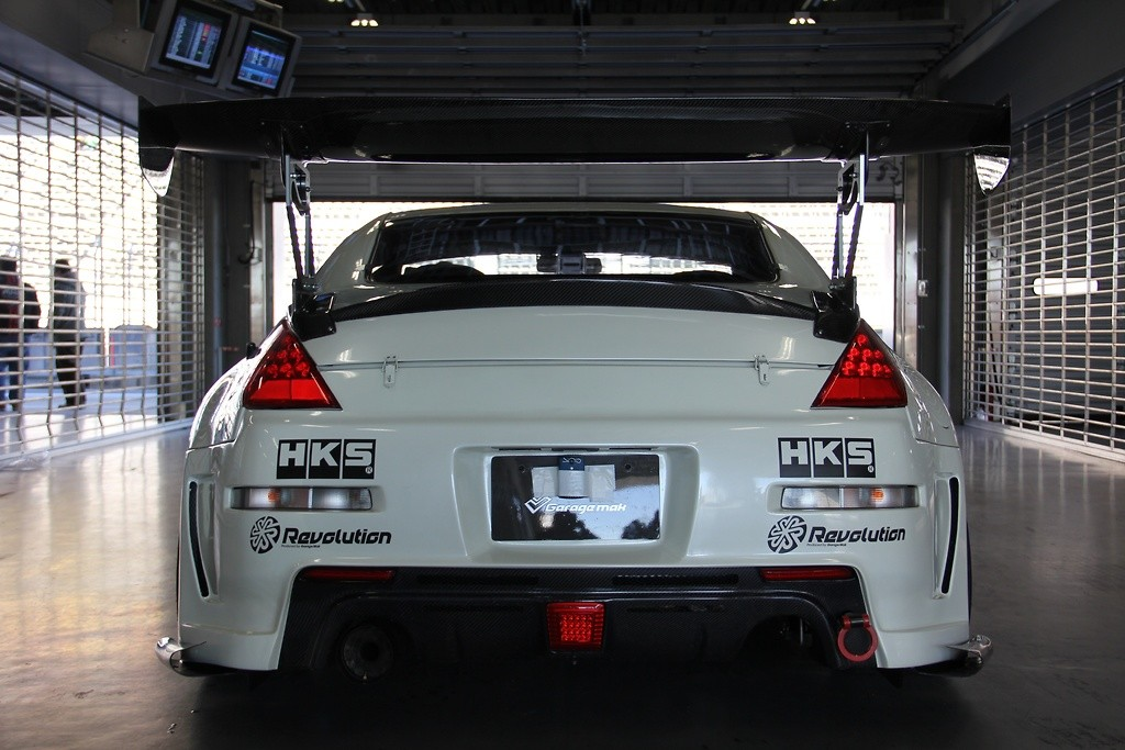Rear Bumper Diffuser - Construction: FRP - Colour: Unpainted - GMREV0-Z33-RBDFRP