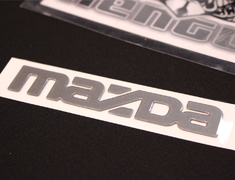 "RX-7 - FD3S - Rear ""mazda"" Ornament - Category: Exterior - FD49-51-711"