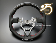 TAKUMI Black Leather/Red Stitch Steering Wheel