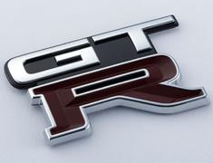Skyline GT-R - BNR32 - EMBLEM-REAR (732) - OEM Part Number: 84896-05U05 - 84896-RHR25