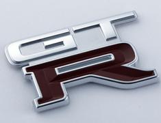 Skyline GT-R - BNR32 - EMBLEM-REAR (KL0) - OEM Part Number: 84896-05U11 - 84896-RHR28