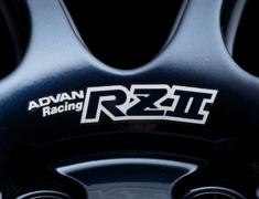- ADVAN Racing RZâ…¡ dedicated sticker between nut holes - Colour: White - Quantity: 2 - Wheel: Racing Hyper Black & Ring / Racing Gloss Black & Ring / Racing Indigo Blue & Ring - V1964