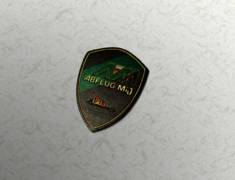 - Colour: Green, Black & Gold (Brass) - Size: W50mm H70mm - Mij Crest Emblem